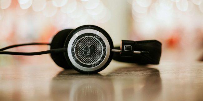 black headphones against a twinkle light background